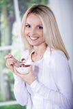 Woman with yogurt bowl Stock Photo