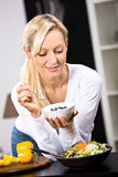 Woman with yogurt bowl Royalty Free Stock Photos