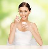 Woman with yogurt Royalty Free Stock Image