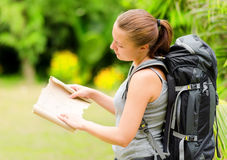 Young woman with backpack in a woods Stock Photography