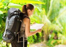 Young woman with backpack in a woods Royalty Free Stock Image