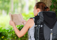 Young woman with backpack in a woods Stock Image