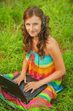 Woman young beautiful laptop headphones Royalty Free Stock Image