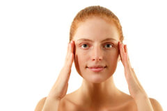 Woman young beautiful no make-up touching face Royalty Free Stock Photography