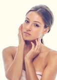 Woman  young beautiful portrait tan hands on face Royalty Free Stock Photos