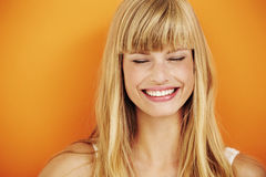 Woman. Young blond woman laughing in studio Stock Images