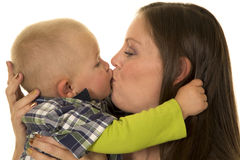 Woman and young boy kissing Stock Photography