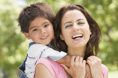 Woman and young boy outdoors embracing and smiling Royalty Free Stock Photo