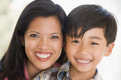 Woman and young boy smiling Stock Images