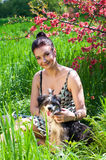 Woman with young Chinese crested dog Royalty Free Stock Photos