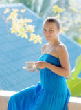 Young woman drinking coffee on morning terrace Royalty Free Stock Images