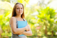 Young female student outdoor portrait Royalty Free Stock Photo