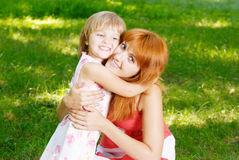 Woman and young girl Stock Images
