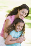 Woman and young girl  embracing and smiling Royalty Free Stock Image
