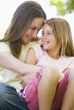 Woman and young girl  embracing and smiling Royalty Free Stock Photos