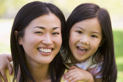 Woman and young girl outdoors embracing Royalty Free Stock Photography