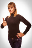 Woman young girl shows positive sign thumbs yes, Stock Photos