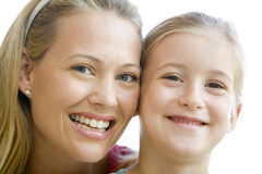 Woman and young girl smiling Royalty Free Stock Photography