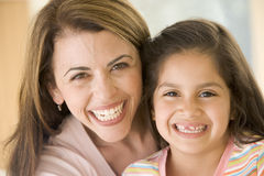 Woman and young girl smiling. Close up of woman and young girl smiling Stock Photo