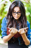 Woman young glasses reading Royalty Free Stock Photos