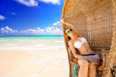 Woman young lady with sunglasses relaxing on the tropical beach Stock Image