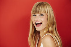 Woman. Young woman laughing on red, portrait Royalty Free Stock Image