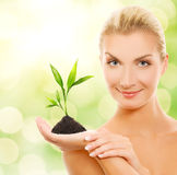 Woman with young plant Royalty Free Stock Photo