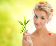 Woman with young plant Stock Photography