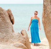 Young woman on a rocky beach Stock Photo