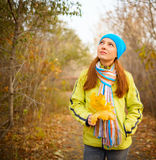 Young woman walking in the fall season Royalty Free Stock Photography