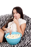 Woman zebra blanket eating popcorn Royalty Free Stock Photo