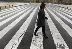 Woman in zebra crossing Stock Photography