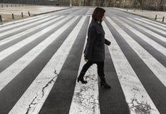 Woman in zebra crossing. Woman on zebra crossing road, signs stock photography