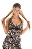 Woman zebra dress black hat hold hair Stock Photos