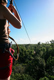 Woman on a zipline. Adventure in a tropical forest in Mexico royalty free stock photo