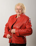 Woman zipping red jacket. Stock Photo