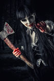 Woman zombie with bloody axe Royalty Free Stock Photos
