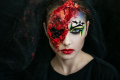 Woman zombie. Portrait of scary witch, part of brain & one eye gouged out. Big terrible scar on beautiful young face. Black veil on her head. Corpse Bride brutal Stock Photo