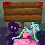 Woman zombie with wooden sign Stock Images