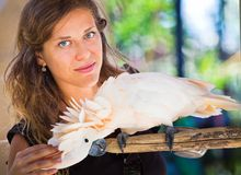 Woman in zoo with parrot Royalty Free Stock Photography