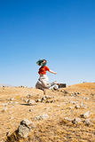 Woman and Zorats Karer area in Armenia Royalty Free Stock Image