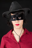 Woman with zorro mask. Young woman with zorro mask wearing a red dress Royalty Free Stock Photography