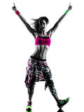 Woman zumba fitness exercises dancer dancing isolated silhouette. One caucasian woman zumba fitness exercises dancer dancing isolated in silhouette on white Royalty Free Stock Photo
