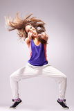 Womand dancer pointing to you. Young stylish girl dancing modern ballet dance , with a headbanging move and pointing to you Royalty Free Stock Photo
