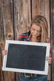 Womand holds chalk board sign Royalty Free Stock Images