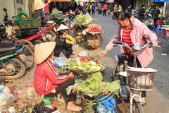 Womand selling fruits and vegetables in a street market of Hoàn Kiếm, the old quarter of Hanoi Stock Image