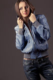 Womanin in blue jeans and leather jacket Royalty Free Stock Photo