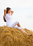Womanis sitting on a straw Stock Photo
