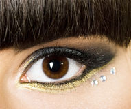 Womanish eye with brilliants Royalty Free Stock Image