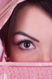 Womanish eye in pink yashmak Stock Images